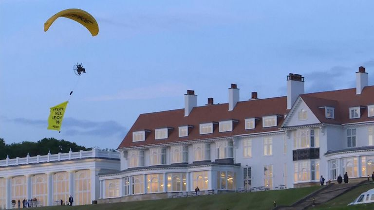 A protester flew a paraglider above Trump Turnberry trailing a banner with  the words