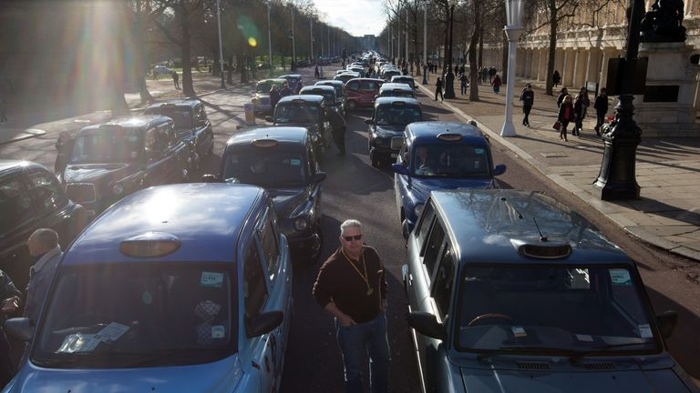 Black cab drivers take part in a strike to protest against Uber in  2016