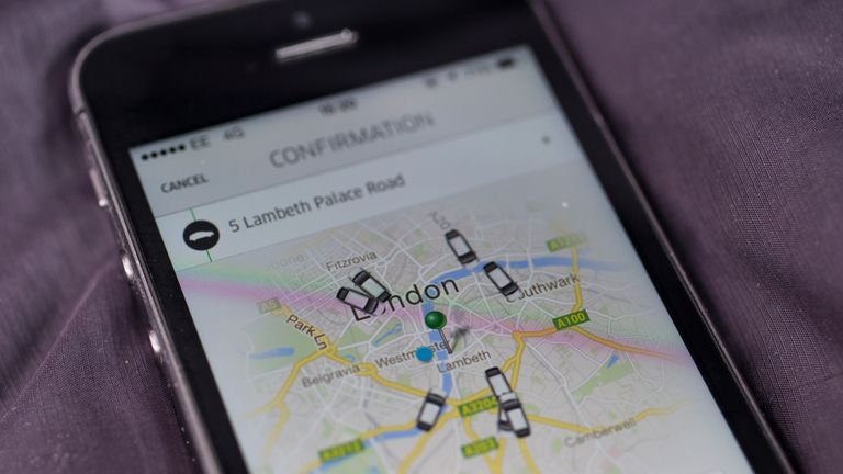 LONDON, ENGLAND - JUNE 02: In this photo illustration, a smartphone displays the 'Uber' mobile application which allows users to hail private-hire cars from any location on June 2, 2014 in London, England. The controversial piece of software, which is opposed by established taxi drivers, currently serves more than 100 cities in 37 countries. London's black cabs are seeking a High Court ruling on the claim that the Uber software is breaking the law by using an app as a taxi meter to determine rat