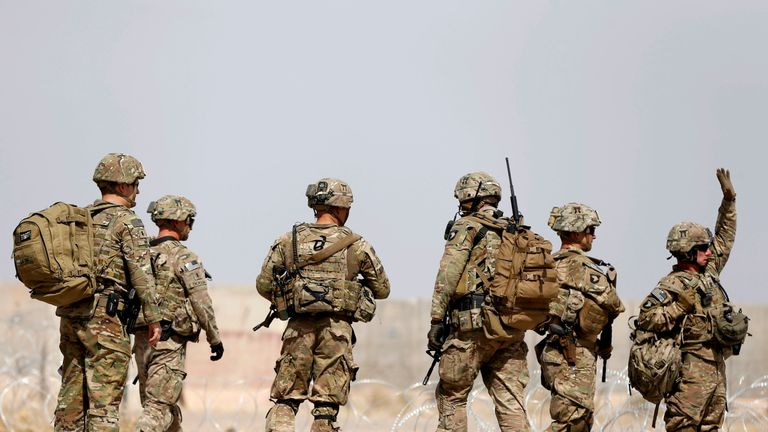 US troops walk outside their base in Uruzgan province, Afghanistan July 7, 2017