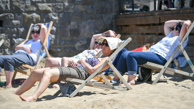 Sunseekers enjoy the hot weather on the beach at Weston-super-Mare