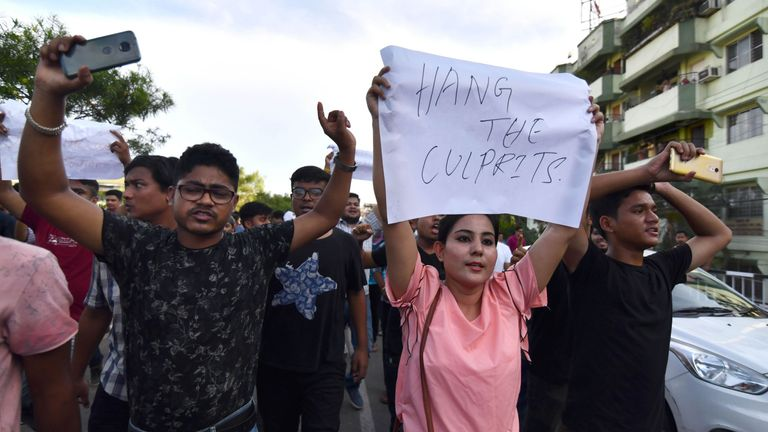 This photo taken on June 10, 2018 shows Indian protesters demanding the arrest and punishment of people involved in the killing of two men in Karbi Anglong district, during a protest in Guwahati, the capital city of Indias northeastern state of Assam