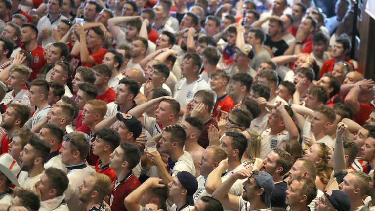 England fans watch England take on Sweden in the World Cup quarter finals at Ashton Gate World Cup fans village at the Bristol City football club on July 7, 2018 in London