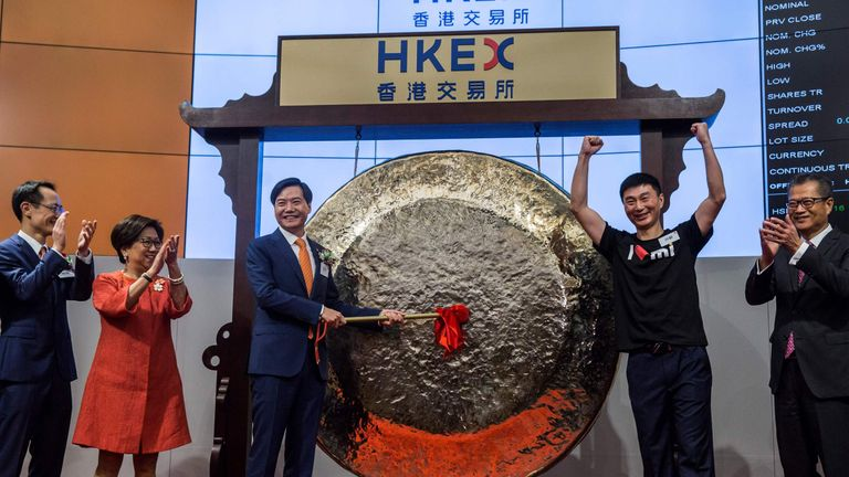 Xiaomi founder Lei Jun hits a gong at the company's initial public offering launch on the Hong Kong Stock Exchange.
