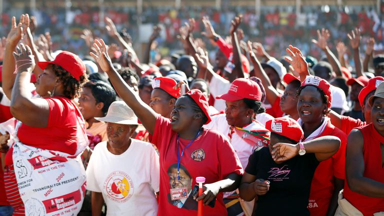 Supporters of Zimbabwe's opposition party attend a rally in Chitungwiza, outside Harare, Zimbabwe, July 26, 2018