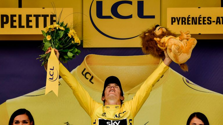 Geraint Thomas celebrates after confirming his victory in the Tour de France on stage 20