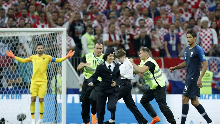 Pitch invaders are apprehended during the World Cup final