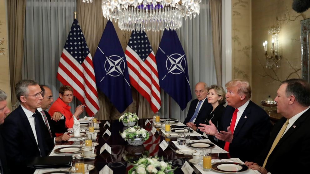 Donald Trump and NATO Secretary General Jens Stoltenberg attend a bilateral breakfast ahead of the NATO Summit in Brussels