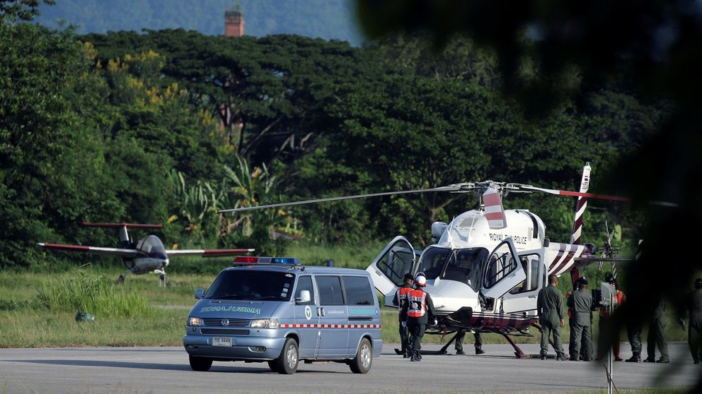 An ambulance carrying rescued schoolboys travels to a hospital from a military airport in Chiang Rai, Thailand