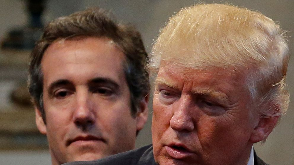 Republican presidential nominee Donald Trump's personal attorney Michael Cohen stands behind Trump as a group of supporters lay hands on Trump in prayer during a campaign stop at the New Spirit Revival Center church in Cleveland Heights, Ohio, U.S. September 21, 2016. Picture taken September 21, 2016. REUTERS/Jonathan Ernst