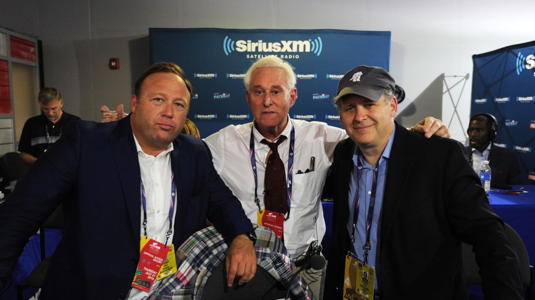 CLEVELAND, OH - JULY 21: Alex Stone, of Infowars, Roger Stone, former Donald Trump advisor, and Jonathan Alter pose for a photo following an episode of Alter Family Politics on SiriusXM at Quicken Loans Arena on July 20, 2016 in Cleveland, Ohio. (Photo by Ben Jackson/Getty Images for SiriusXM)
