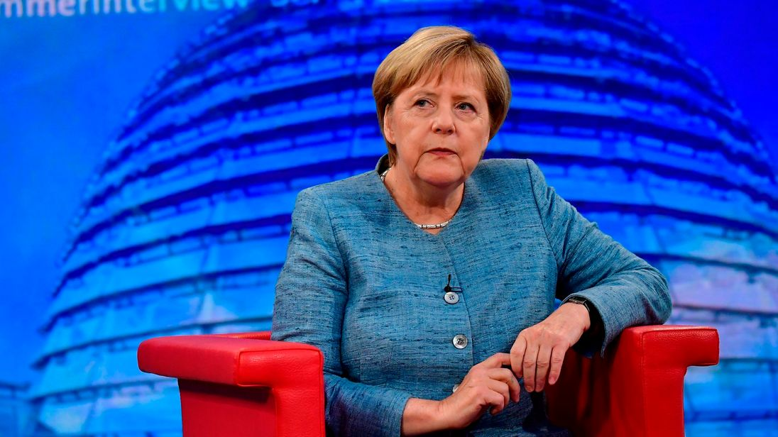 German Chancellor Angela Merkel looks on during her traditional summer interview at a TV studio of German public broadcaster ARD