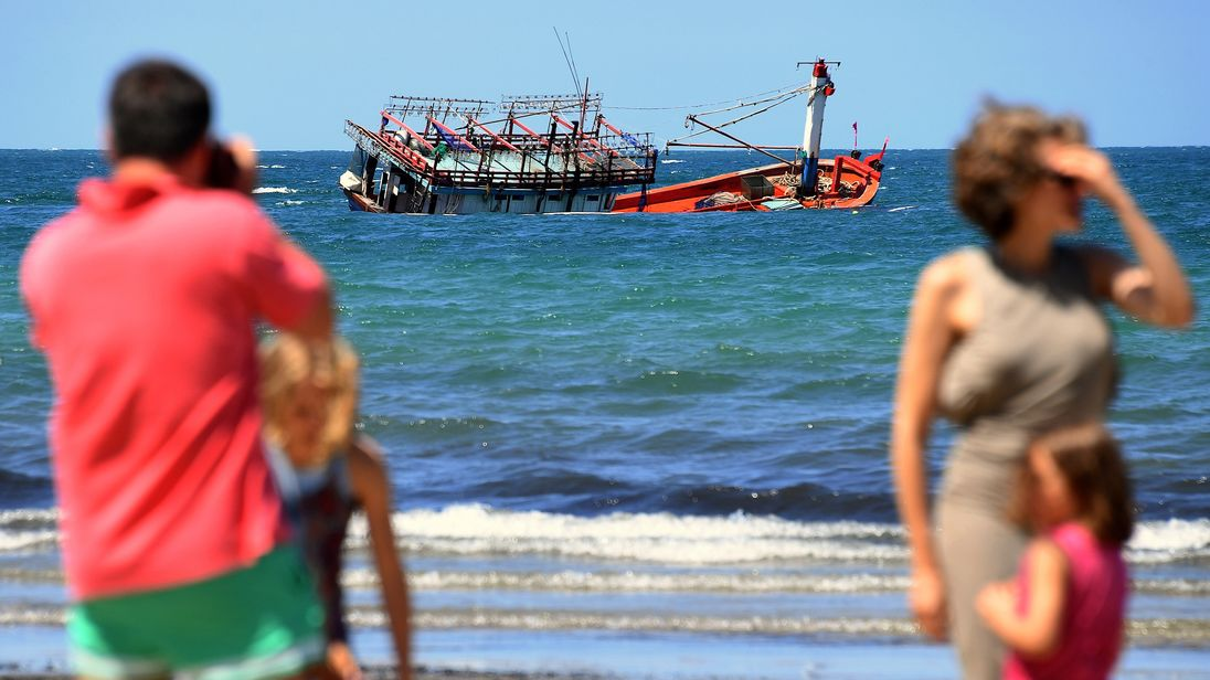boat of asylum seekers runs aground in crocodile infested waters in