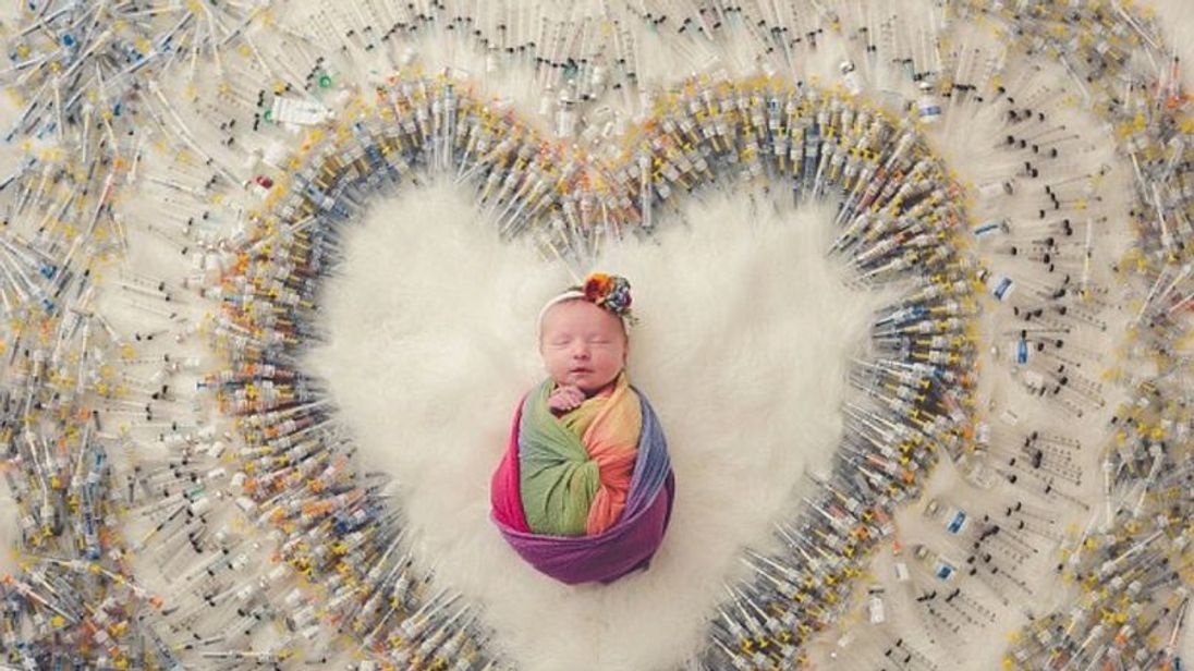 my baby daughter surrounded by needles is a symbol of hope for those