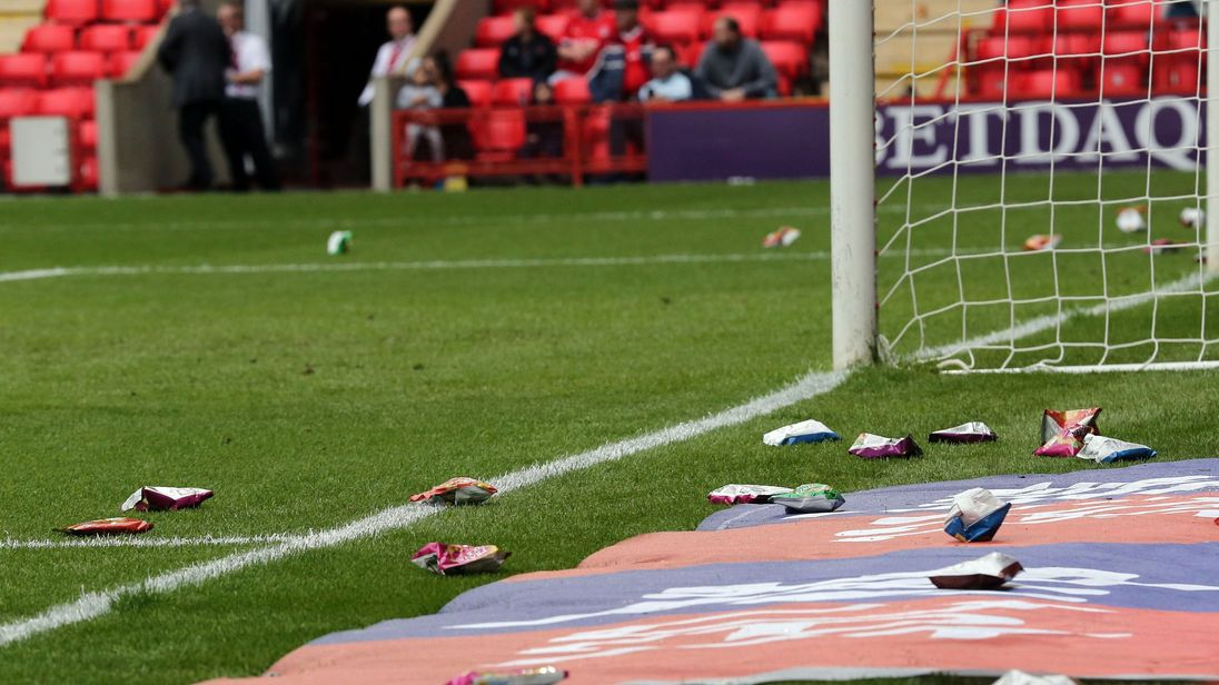 The game is delayed whilst crips packers are removed from the pitch as part of a Protest during Charlton Athletic vs Fleetwood Town, Sky Bet EFL League 1 Football at The Valley on 25th August 2018