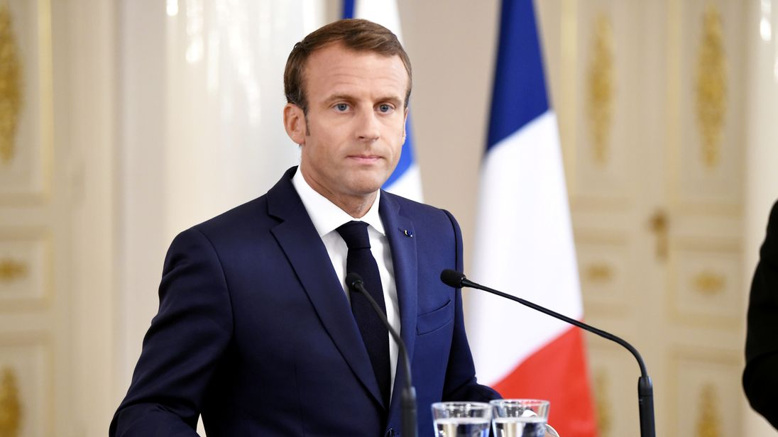 French President Emmanuel Macron reacts during a news conference with Finland's President Sauli Niinisto
