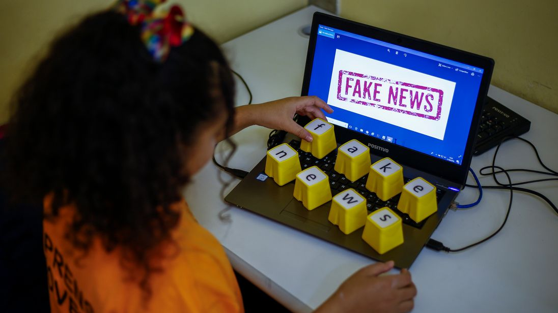 Students of Unified Educational Centers (CEU) attend a lesson on 'Fake News: access, security and veracity of information', in Sao Paulo, Brazil on June 21, 2018. - Media analysis is a compulsory subject in Brazilian schools. (Photo by Miguel SCHINCARIOL / AFP) (Photo credit should read MIGUEL SCHINCARIOL/AFP/Getty Images)