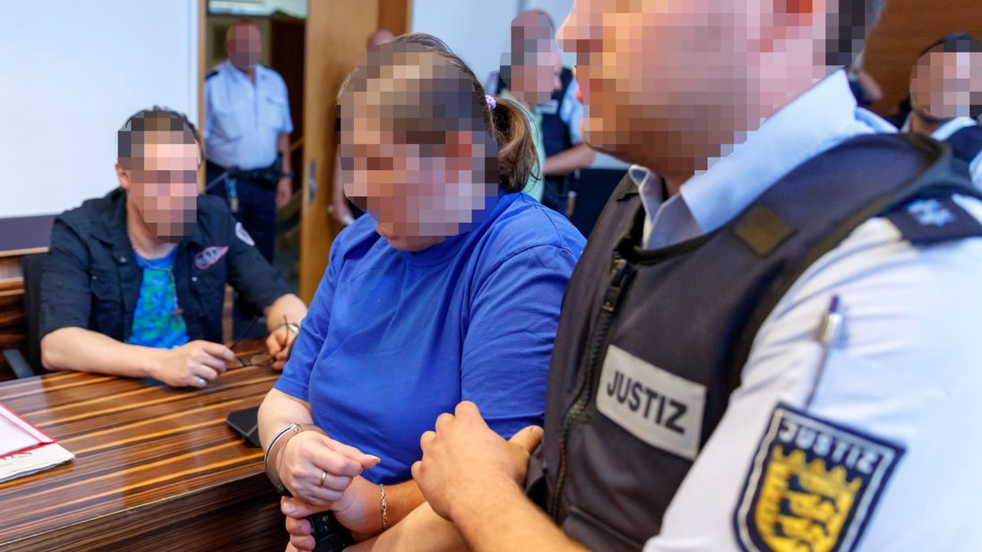 FREIBURG GERMANY- AUGUST 07 ATTENTION EDITORS Pixelation done in accordance with court orders. Defendants Christian L. and Berrin T. arrive for their pronouncement of judgement on charges related to sexual abuse of a minor at the regional cour