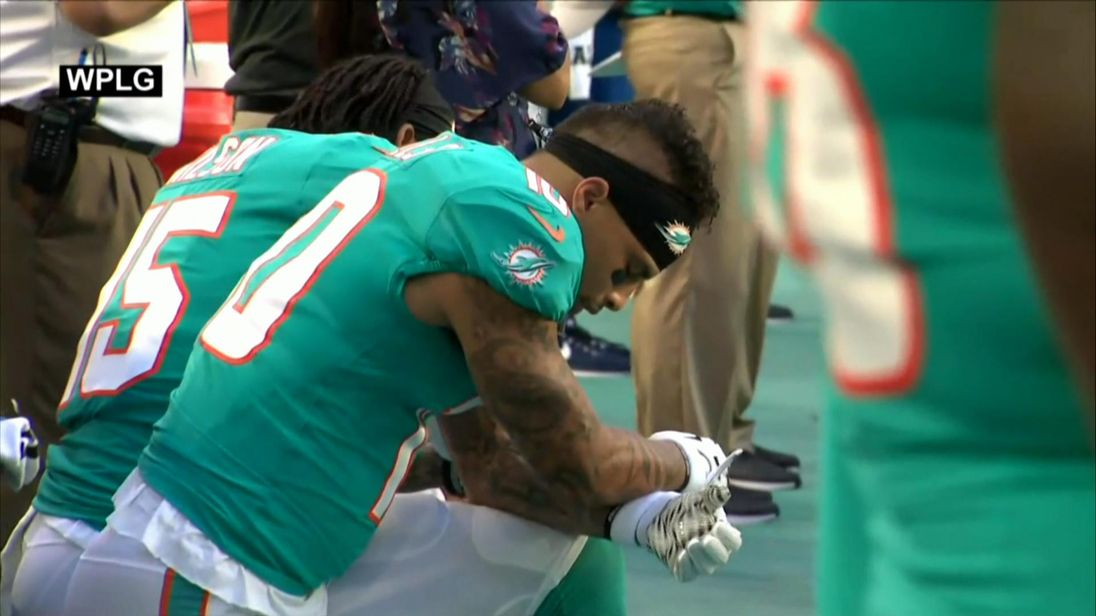 Three Dolphins players protest during national anthem before exhibition game