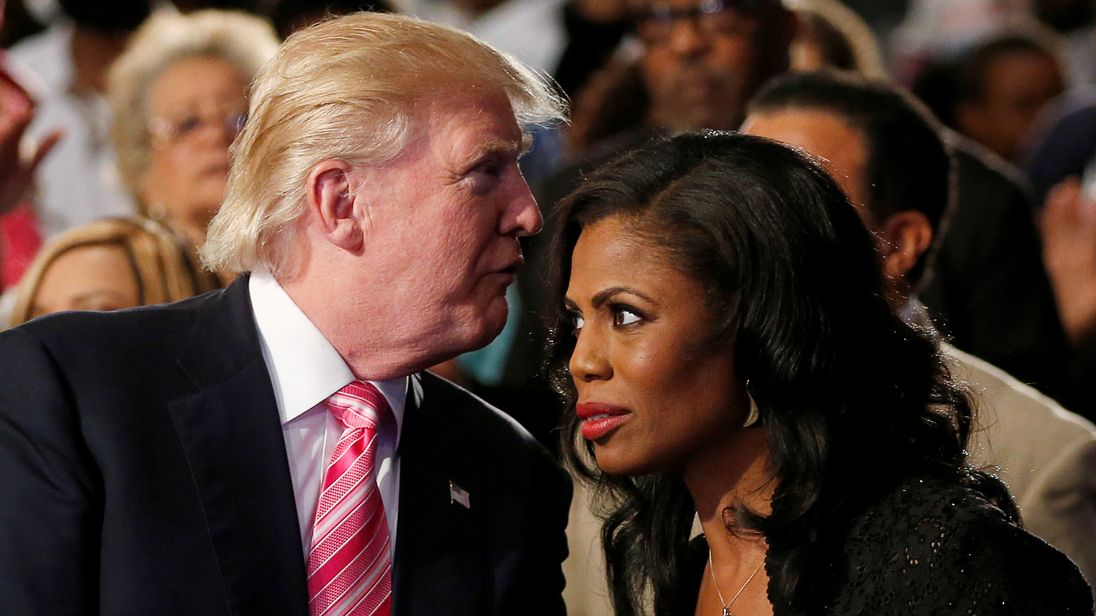 Republican presidential nominee Donald Trump and Omarosa Manigault attend a church service in Detroit Michigan U.S. September 3 2016