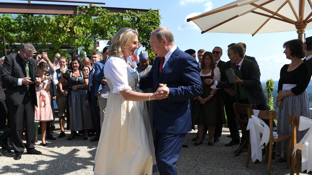 Russian President Vladimir Putin dances with Austrian Foreign Minister Karin Kneissl at her wedding