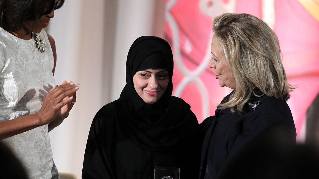 2012: Samar Badawi is presented with an International Women of Courage Award by Hillary Clinton in Washington DC