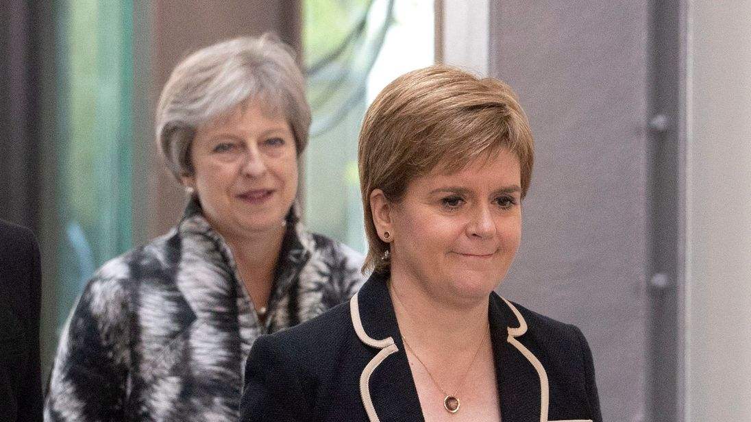 """Theresa May, left, has said Nicola Sturgeon, right, should not try to """"sow the politics of division""""."""