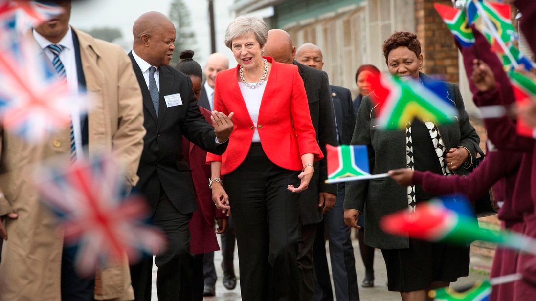 Theresa May is greeted by schoolchildren in Guglethu township, Cape Town