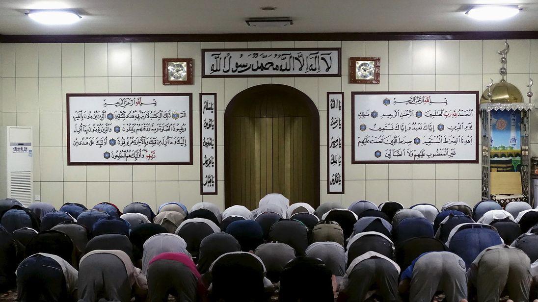 Muslims pray at a mosque during Ramadan in Urumqi, Xinjiang