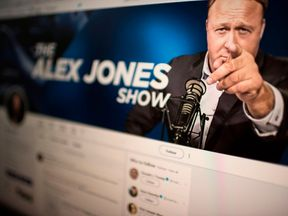 Picture showing a computer screen displaying the Twitter account of Far-right conspiracy theorist Alex Jones taken on August 15, 2018 in Washngton DC. - Far-right conspiracy theorist Alex Jones said his Twitter account had been suspended for a week, the latest online platform to take action against the activist. Twitter suspended the personal account of Jones, who operates the Infowars website that has disputed the veracity of the September 11 attacks, the Sandy Hook school massacre and other ev