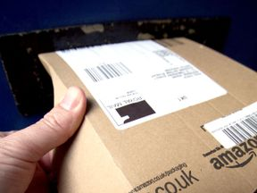 File photo dated 26/04/13 of the Amazon logo on packaging, as the retailer has been told to clarify that some items on its Prime service are not available for next-day delivery after the advertising regulator ruled it was misleading consumers.