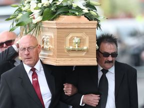 Paul carries the coffin