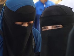 Women take part in a protest against the burka ban in Denmark