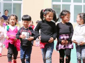 Attitudes towards pregnancy and child birth are changing in China, as children learn about pregnancy on Mother's Day. File pic