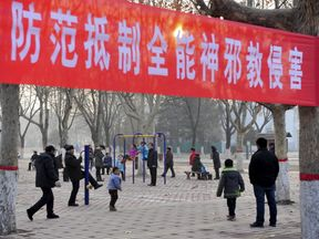 A banner which reads 'Prevent and reject the Church of Almighty God's cult invasions'