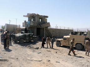 Afghan security forces inspect the aftermath of a suicide bomb blast in Gardez last year. File pic