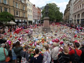 Flowers left in St Ann's Square in Manchester