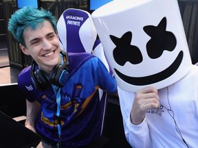 Ninja poses alongside fellow gamer Marshmello during the Epic Games Fortnite E3 Tournament