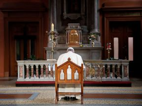 Pope Francis prays for survivors of abuse inside St Mary's Pro Cathedral in Dublin