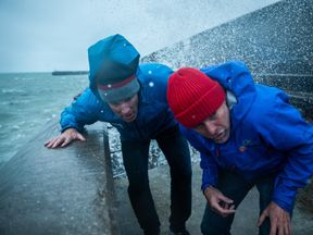 Lewis and his skipper take cover as a big wave explodes over the Brighton Marina wall