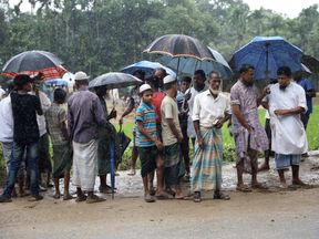 Refugees stand by a road in Kutupaloong refugee camp in Cox's Bazar, Bangladesh