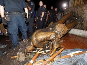 University of North Carolina police surround the toppled statue of a Confederate soldier nicknamed Silent Sam on the school's campus after a demonstration for its removal in Chapel Hill, North Carolina, U.S. August 20, 2018. REUTERS/Jonathan Drake