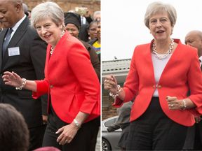 Theresa May joins school children in dancing with Angie Motshekga, South African Minister of Basic Education
