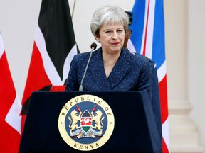Theresa May addresses a joint news conference with Kenya's President Uhuru Kenyatta at the State House in Nairobi, Kenya