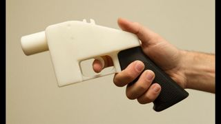 3D printed gun being held.
