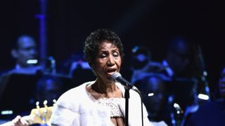 Aretha Franklin lies in state in red dress and heels