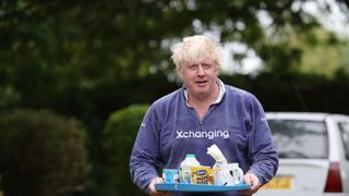 Boris Johnson brings tea for the press to drink outside his house