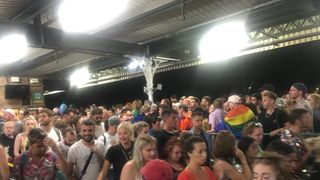 crowds of people at Brighton train station following Brighton Pride