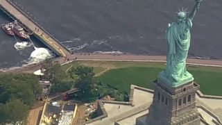 Gas canister fire sparks Liberty Island evacuation