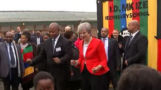 Theresa May dances outside a school in Cape Town